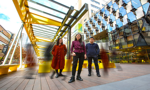 A photo of RMIT University computer scientists (from left) Flora Salim, Nan Gao, and Wei Shao.